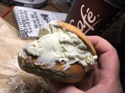 Bagel overloaded with herb cream cheese