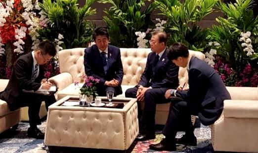 Moon Jae-in with Shinzo Abe