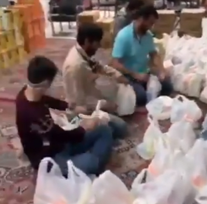 Youth in Qom packing food