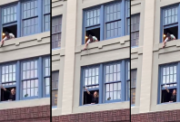 Video of a man offering wine to neighbour girl through window goes viral amid Coronavirus lockdown in Italy