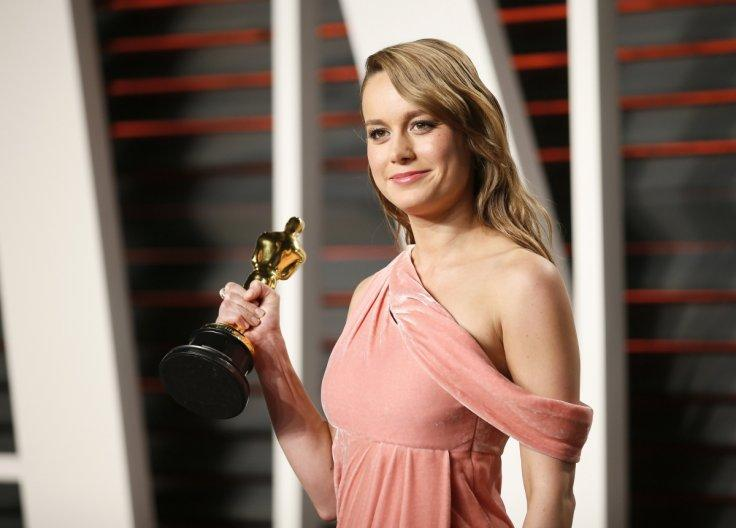 Actress Brie Larson holds her award for Best Actress i