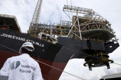 SembCorp industries posts 56% drop in third quarter profits