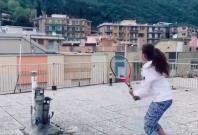 Two Italian girls play rooftop tennis amid Coronavirus lockdown.