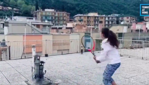 Two Italian girls play rooftop tennis amid Coronavirus lockdown.
