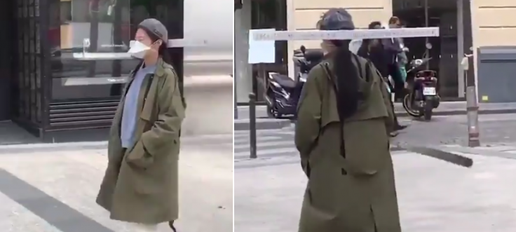 Social distancing done right? A woman walks with this unique headgear in Paris