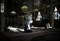 Iranian muslims pray before breaking Fast