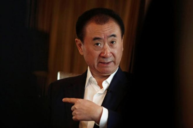 Who is Wang Jianlin, and what's behind his obsession with Holly-wood assets?