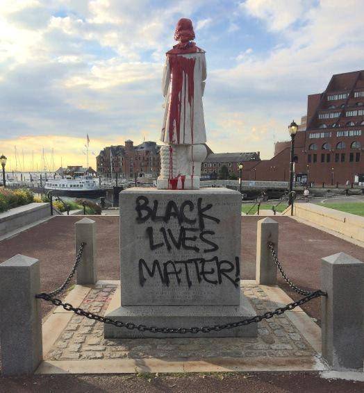 Columbus statue painted red