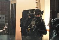 Counter-terrorism police storm a flat
