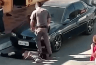 Police Standing on Neck of Brazilian Woman