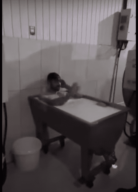 Man taking bath at milk factory