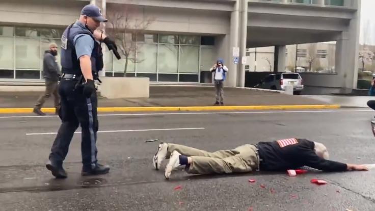 Old White Man Shows Gun to Antifa