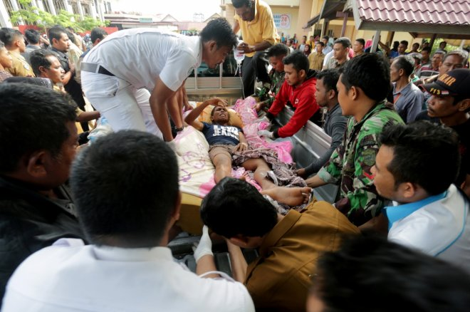 In Pictures: Heartwarming images of Aceh earthquake that killed more than 100
