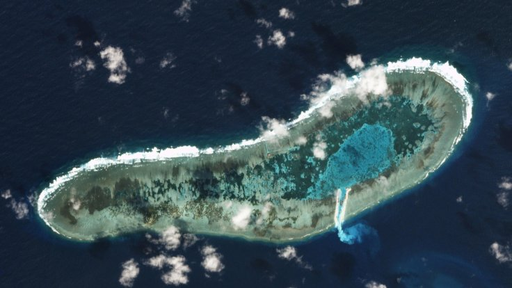 Vietnam dredges on disputed reef in South China Sea