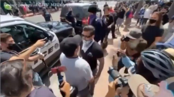 White Lives Matter member punches Asian Man