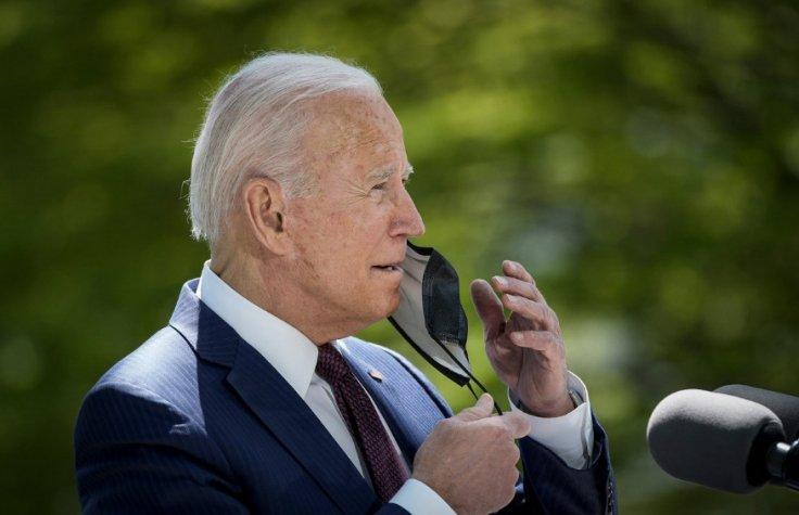 Biden opening his mask