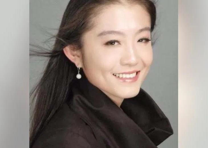Zhe 'Shelly' Wang