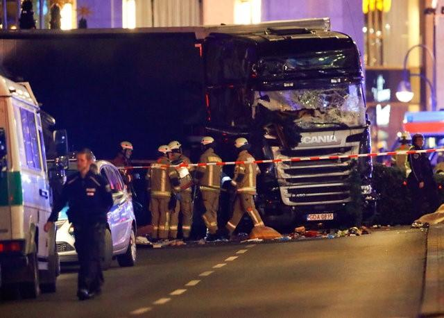 berlin terror attack as lorry plows into crowd killing 12