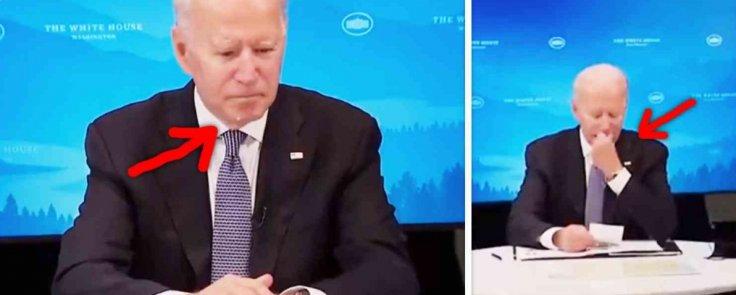 Biden wiping face