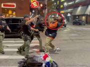 Cop punching man