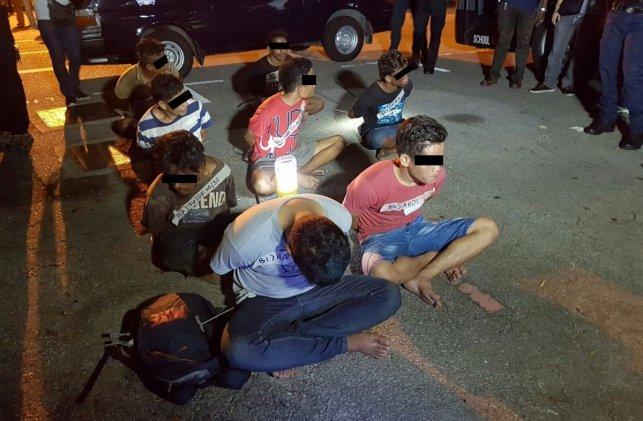8 Indonesian men arrested