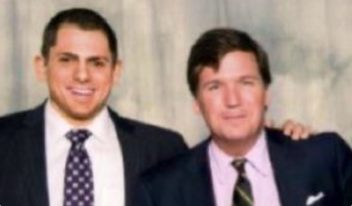 Tucker Carlson pictured with Anton Lazzaro