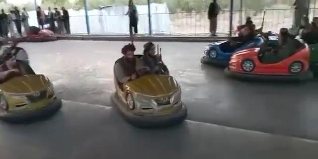 Taliban militant enjoying rides