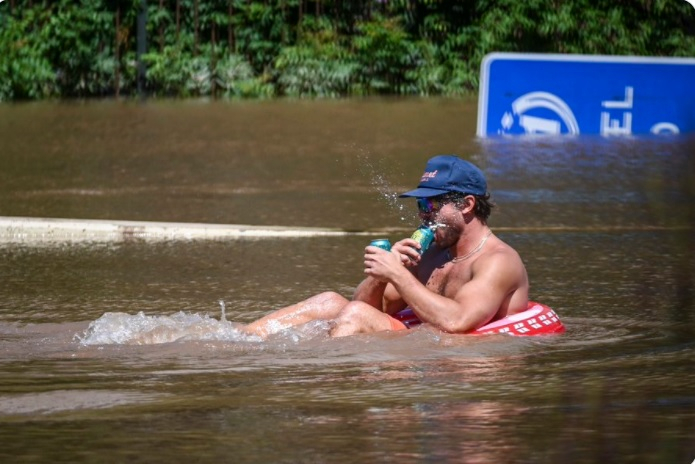 Man attempted to float along the floodwaters