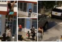 A woman in underwear runs down a street to escape the wrath of her boyfriend's wife