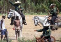 Border Patrol using whips against Haitian refugees