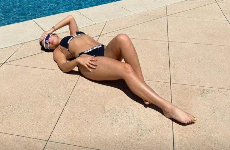 Addison Rae looks smoking hot in black swimsuit