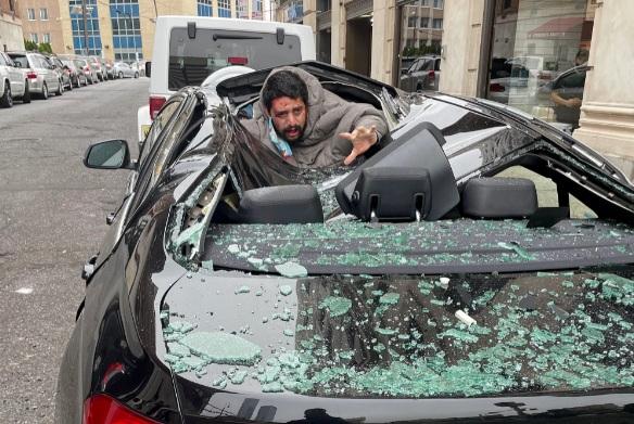 Man falls on BMW