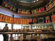 Investors monitor stock market prices in Kuala Lumpur