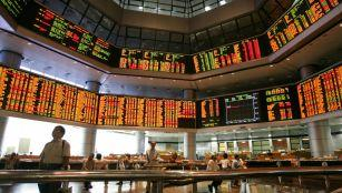 Investors monitor stock market prices in Kuala Lumpur