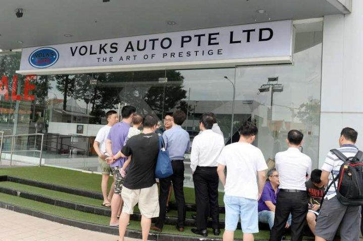 People gathering outside Volks Auto. Former employee Koh Chek Seng was charged with conspiring to commit criminal breach of trust. Photo: ST FILE