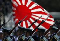 Japan public divided as laws easing limits on military take effect