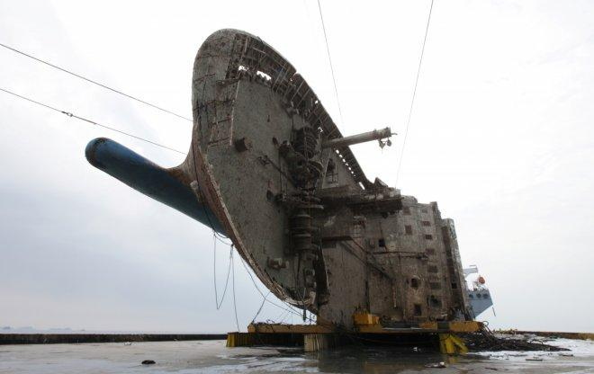 The sunken ferry Sewol sits on a semi-submersible ship during its salvage operations at the sea off Jindo, South Korea, in this handout picture provided by the Ministry of Oceans and Fisheries