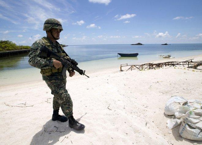 Philippines' President Duterte cancels visit to disputed South China Sea island after China's warning