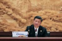 China's Xi Jinping says Belt and Road Initiative needs to reject protectionism, 30 leaders agree to support