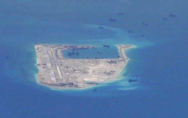 China installs rocket launchers on disputed South China Sea island