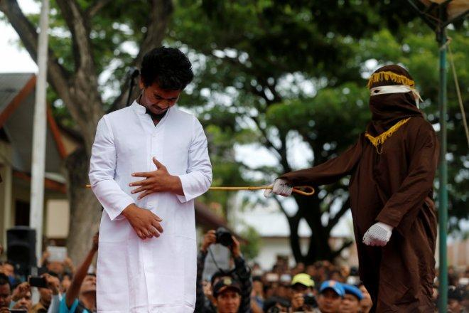 Gay couple in Indonesia caned 83 times in public