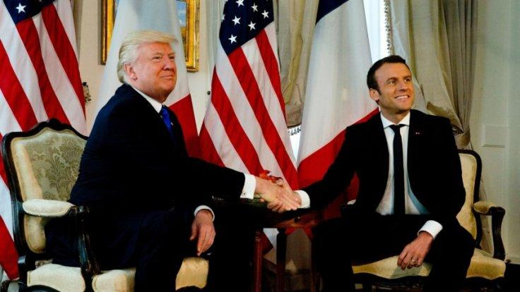Donald Trump finally meets his hand shake match In Emmanuel Macron