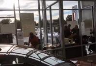 Deadly shootout captured on camera in car dealership