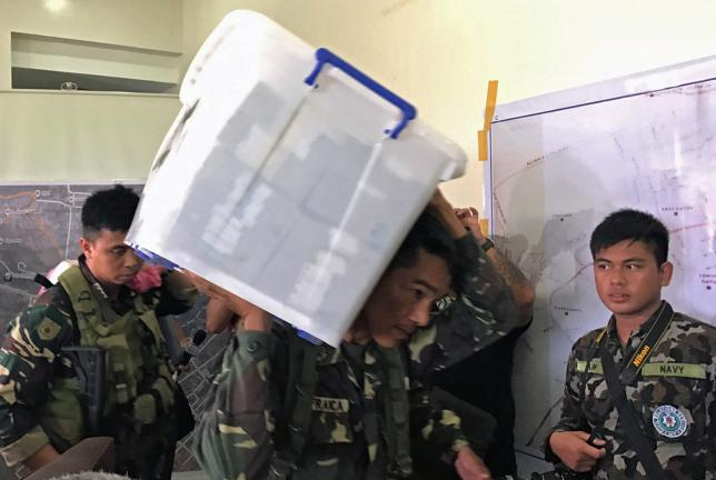 Philippine troops find stash of banknotes as fighters pull back