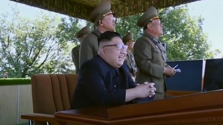 Watch a childlike Kim Jong-un chuckle at North Korean military display