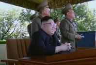 Watch a childlike Kim Jong-un chuckle at North Korean military display