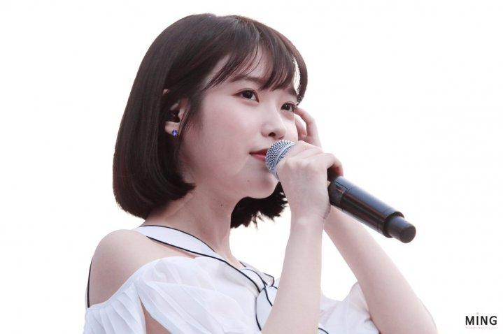 Fans are awed by IU's charm
