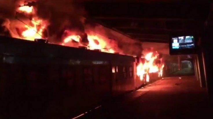 Angry South African commuters torch trains and riot at Cape Town railway station