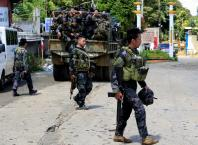 Philippines says Islamist militants withdraw from school, no casualties