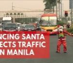 dancing-filipino-traffic-cop-in-santa-claus-costume-directs-traffic-in-manila